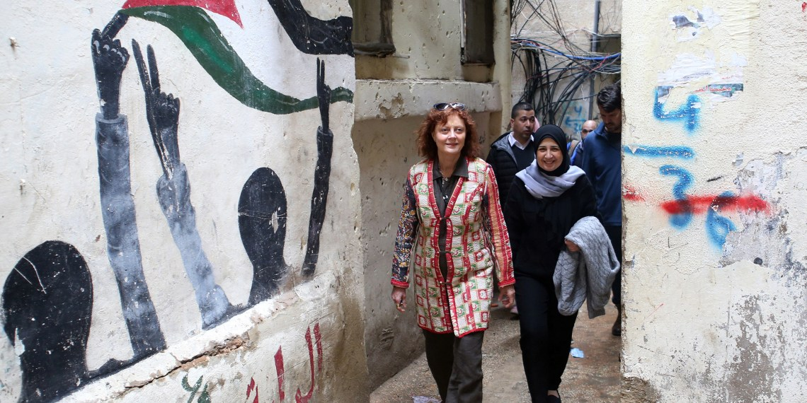 Hollywood actress and social activist Susan Sarandon walks with Mariam Shaar, a Palestinian entrepreneur in Burj al-Barajneh refugee camp in Beirut, Lebanon March 4, 2019. Picture taken March 4, 2019. REUTERS/Mohamed Azakir