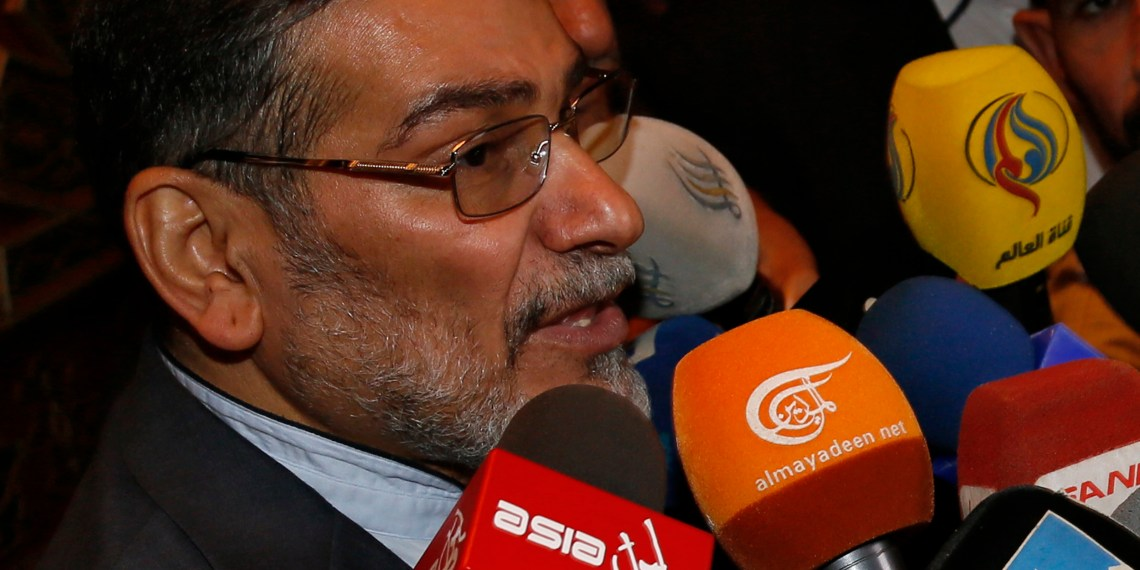 FILE PHOTO: Admiral Ali Shamkhani, Iran's Supreme National Security Council Director, speaks to the media after his arrival at Damascus airport, September 30, 2014. REUTERS/Khaled al-Hariri
