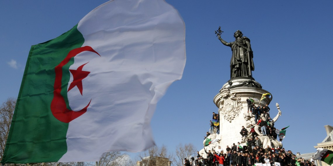 FILE PHOTO: Protestors hold Algerian flags as they attend a demonstration against President Abdelaziz Bouteflika on the Place de la Republique, in Paris, France, March 10, 2019. REUTERS/Philippe Wojazer