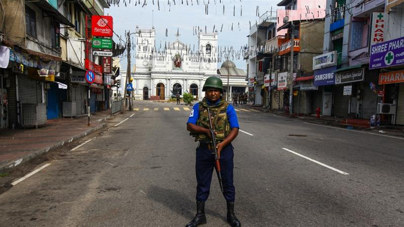 A security personnel stands guard near St Anthony's Shrine in Colombo [Anadolu/Chamila Karunarathne]