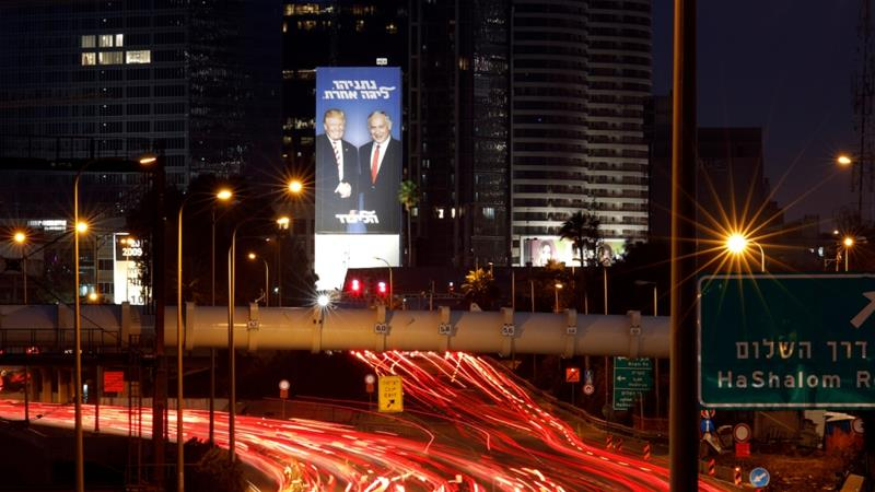 A Likud election campaign billboard, depicting US President Trump shaking hands with Israeli PM Netanyahu, is seen at a main entrance to Tel Aviv, Israel, February 5, 2019 [Amir Cohen/Reuters]
