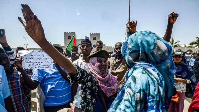 Sudanese women chant slogans during a rally demanding a civilian body to lead the transition to democracy [Mohammed Hemmeaida/AFP]