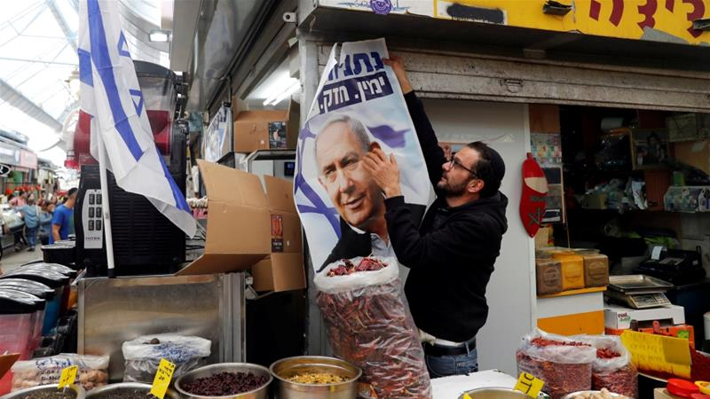 Netanyahu is the first sitting prime minister due to be indicted on corruption charges [Ronen Zvulun/Reuters]