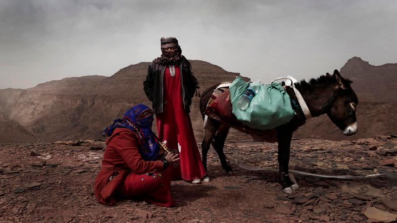 In this March 30, 2019 photo, Umm Yasser, the first Bedouin female guide from the Hamada tribe, looks at Umm Soliman as she plays the flute, near Wadi Sahw, Abu Zenima, in South Sinai, Egypt. (AP)