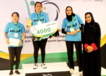 The first three winners with Saudi Bowling Federation's member of the board of directors Razan Baker. (Photo supplied)
