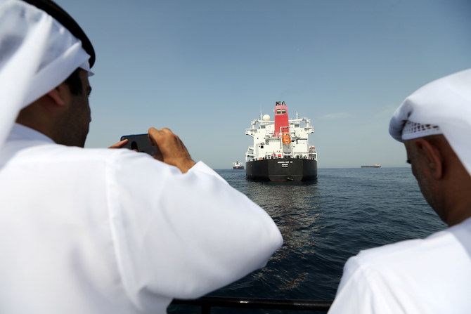 Port officials take a photo of the damaged tanker Andrea Victory at the Port of Fujairah, UAE. (File/Reuters)