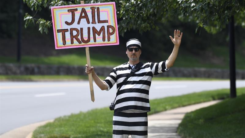 A protesters stands outside the Trump National Golf Club in Sterling, Virginia, as he waits for President Trump to depart on June 16, 2019 [AP/Susan Walsh] [Daylife]