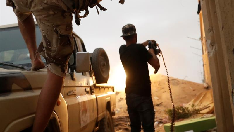 Fighters loyal to Libya's UN-recognised government (GNA) fire guns during clashes with forces loyal to Khalifa Haftar on the outskirts of Tripoli on May 25 [Reuters/Goran Tomasevic]