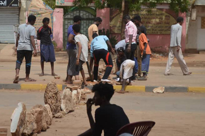 Bricks are laid by protesters to block a street in the Sudanese capital Khartoum to stop military vehicles from driving through the area on Wednesday, June 5, 2019. (AP)