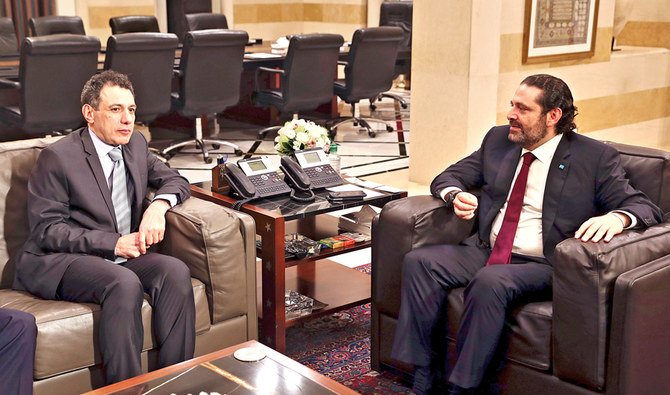 Lebanese Prime Minister Saad Hariri, right, meets with Nizar Zakka at the governmental palace in Beirut, Lebanon, on Tuesday. (AP)