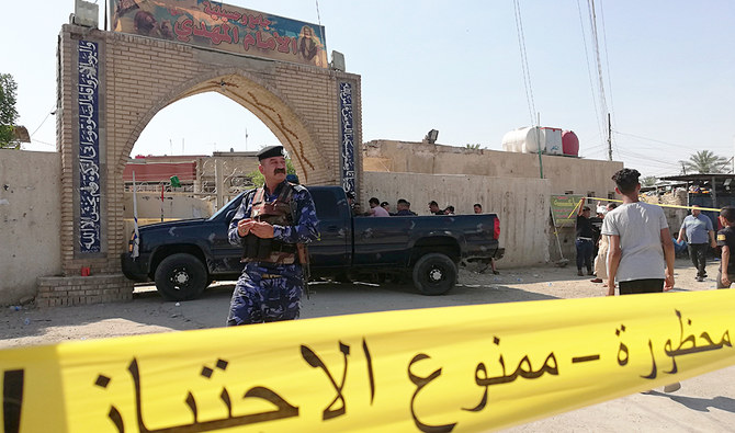 Security forces gather at the site of an attack in Baghdad, Iraq. (AP)