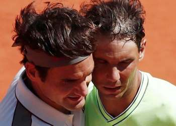 Switzerland's Roger Federer and Spain's Rafael Nadal after their semifinal match at the French Open on June 7, 2019. (Reuters)