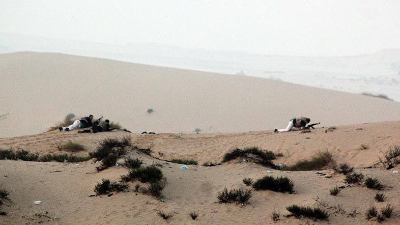 Members of the Egyptian security forces take position on a sand dune during an operation in the northern Sinai peninsula. (File photo: AFP)