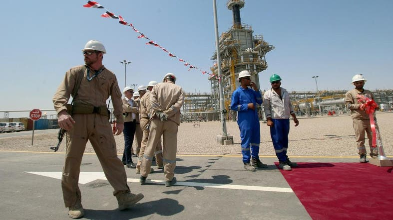 A security personnel stays guard next to Exxon's staff of the West Qurna-1 oilfieldon June 17, 2019. (Reuters)