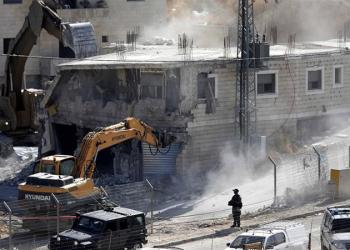 An Israeli army bulldozer demolishes a building in the Palestinian village of Sur Baher in occupied East Jerusalem [Abed al-Hashlamoun/EPA]