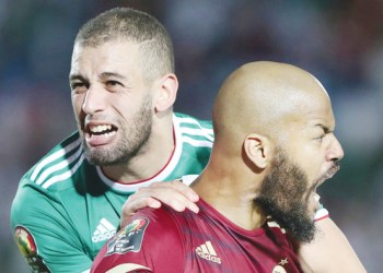 Algeria's Islam Slimani and Rais M'Bolhi celebrate at Egypt's Suez Stadium after Thursday's victory. (Reuters)