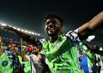 Nigeria's defender Chidozie Awaziem (R) celebrates the win during the 2019 Africa Cup of Nations (CAN) quarter final football match between Nigeria and South Africa at Cairo international stadium. (AFP)