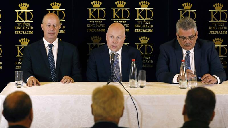 A 2017 photo of Hanegbi, left, during a news conference in Jerusalem [File: Ronen Zvulun/AP]