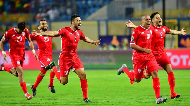 Tunisia's players celebrate their win during the 2019 Africa Cup of Nations (CAN) Round of 16 football match between Ghana and Tunisia at the Ismailia Stadium in the Egyptian city on July 8, 2019. (AFP)