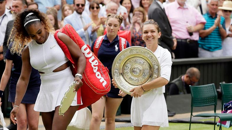 Simona Halep walks away with her trophy after defeating Serena Williams (left), in the women's singles final match on day 12 of the Wimbledon Tennis Championships in London, on July 13, 2019. (AP)