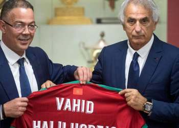 Vahid Halilhodzic poses with Fouzi Lekjaa (L), President of Morocco's Royal Football Federation (FRMF), after signing on as the new coach of the Moroccan national football team in Rabat on August 15, 2019. (AFP)