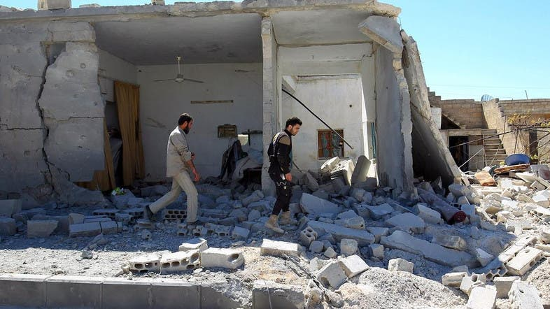Civil defense members inspect the damage at a site hit by airstrikes, in the town of Khan Sheikhoun in rebel-held Idlib. (File photo: Reuters)
