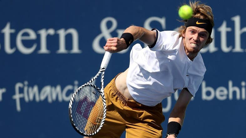 Andrey Rublev of Russia serves to Roger Federer of Switzerland during Day 6 of the Western and Southern Open at Lindner Family Tennis Center on August 15, 2019 in Mason, Ohio. (AFP)