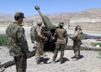 FILE PHOTO: U.S. military advisers from the 1st Security Force Assistance Brigade work with Afghan soldiers at an artillery position on an Afghan National Army base in Maidan Wardak province, Afghanistan August 6, 2018. REUTERS/James Mackenzie/File Photo