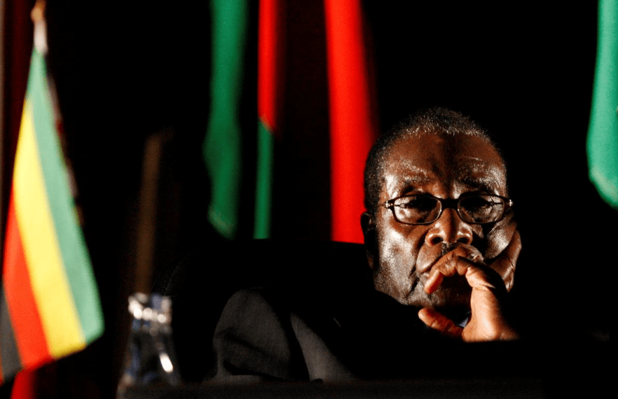 FILE PHOTO: Zimbabwean President Robert Mugabe watches a video presentation during the summit of the Southern African Development Community (SADC) in Johannesburg, August 17, 2008. REUTERS/Mike Hutchings/File Photo
