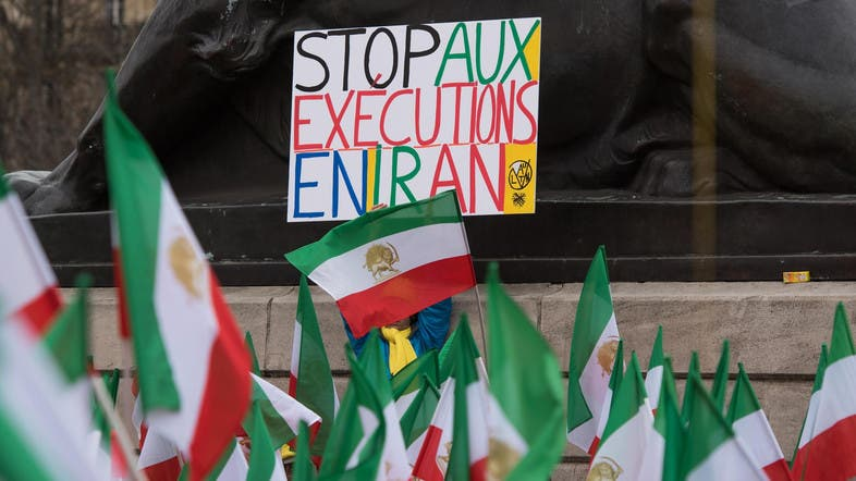 "A demonstrator holds a ""Stop Executions in Iran"" sign during a 2016 demonstration. (File photo: AP)"