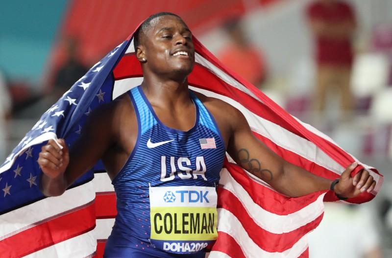 Athletics - World Athletics Championships - Doha 2019 - Men's 100 Metres Final - Khalifa International Stadium, Doha, Qatar - September 28, 2019 Christian Coleman of the U.S. celebrates winning gold in the final REUTERS/Lucy Nicholson