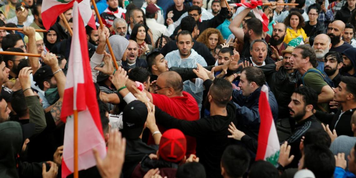Demonstrators confront each other during ongoing anti-government protests in downtown Beirut, Lebanon October 24, 2019. October 24, 2019. REUTERS/Mohamed Azakir