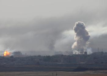 An explosion and smoke are seen over the Syrian town of Ras al-Ain as seen from the Turkish border town of Ceylanpinar, Sanliurfa province, Turkey, October 12, 2019. REUTERS/Stoyan Nenov
