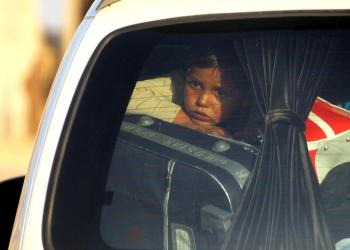 FILE PHOTO: A child is seen in a vehicle with belongings as they flee, in Tel Abyad, Syria October 9, 2019. REUTERS/Stringer