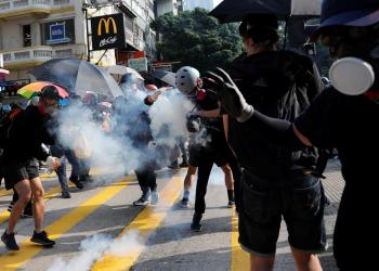 FILE PHOTO: An anti-government protester hits by a tear gas canister during a protest march in Hong Kong, China October 20, 2019. REUTERS/Tyrone Siu