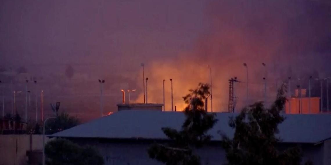 General view of fire burning and smoke billowing out in distance in border town Tel Abyad in Syria seen from Akcakale, Turkey October 10, 2019. REUTERS/ReutersTV