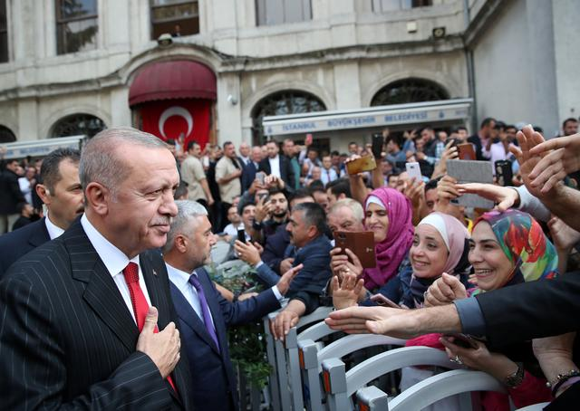 Turkish President Tayyip Erdogan greets people as he leaves from a mosque after the Friday prayers in Istanbul, Turkey, October 18, 2019. Murat Kula/Presidential Press Office/Handout via REUTERS