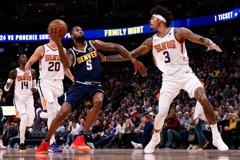 Nov 24, 2019; Denver, CO, USA; Denver Nuggets guard Will Barton III (5) drives to the net against Phoenix Suns forward Kelly Oubre Jr. (3) in the third quarter at the Pepsi Center. Mandatory Credit: Isaiah J. Downing-USA TODAY Sports