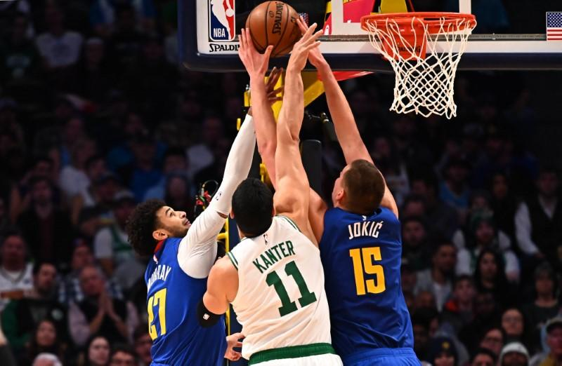 Nov 22, 2019; Denver, CO, USA; Boston Celtics center Enes Kanter (11) and center Nikola Jokic (15) and guard Jamal Murray (27) reach for a rebound in the fourth quarter at the Pepsi Center. Mandatory Credit: Ron Chenoy-USA TODAY Sports