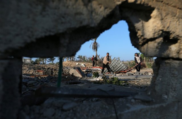 Palestinians inspect a site belonging to Hamas after it was targeted by Israeli warplanes in the southern Gaza Strip November 2, 2019. REUTERS/Ibraheem Abu Mustafa