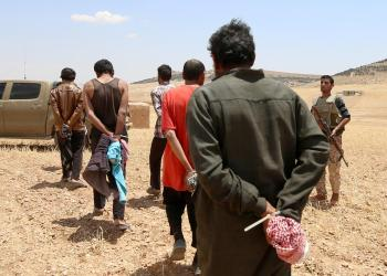 FILE PHOTO: Men, who the Democratic Forces of Syria fighters claimed were Islamic State fighters, walk as they are taken prisoners after SDF advanced in the southern rural area of Manbij, in Aleppo Governorate, Syria May 31, 2016. REUTERS/Rodi Said/File Photo