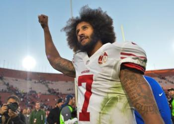 FILE PHOTO: Dec 24, 2016; Los Angeles, CA, USA; San Francisco 49ers quarterback Colin Kaepernick (7) pumps his fist as he acknowledges the cheers from the 49ers' fans after leading his team to a 22-21 come-from-behind win over the Los Angeles Rams at Los Angeles Memorial Coliseum. Mandatory Credit: Robert Hanashiro-USA TODAY Sports