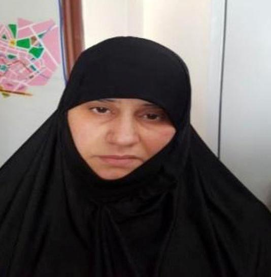 Asma Fawzi Muhammad Al-Qubaysi, believed to be the wife of slain Islamic State leader Abu Bakr al-Baghdadi, who was captured by Turkish security officials, is seen in an unknown location in an undated picture provided by Turkish security officials. Turkish Security Officials/Handout via REUTERS