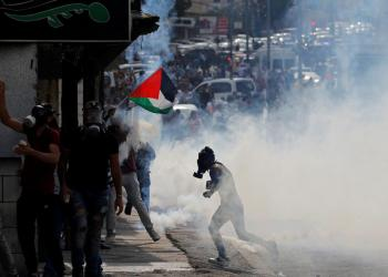 A Palestinian demonstrator runs away from tear gas fired by Israeli forces during an anti-Israel protest in Bethlehem, in the Israeli-occupied West Bank November 14, 2019. REUTERS/Mussa Qawasma