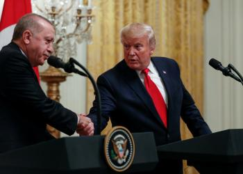 FILE PHOTO: U.S. President Donald Trump and Turkish President Tayyip Erdogan shake hands during a joint news conference at the White House in Washington, November 13, 2019. REUTERS/Tom Brenner/File Photo