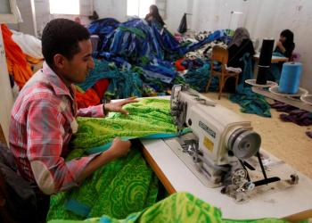 FILE PHOTO: A labourer works at a textile mill in Al-Mahalla al-Kubra, about 110 km north of Cairo March 5, 2014. REUTERS/Mohamed Abd El Ghany/File Photo