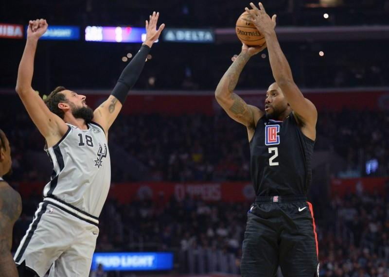 October 31, 2019; Los Angeles, CA, USA; Los Angeles Clippers forward Kawhi Leonard (2) shoots against San Antonio Spurs guard Marco Belinelli (18) during the second half at Staples Center. Mandatory Credit: Gary A. Vasquez-USA TODAY Sports