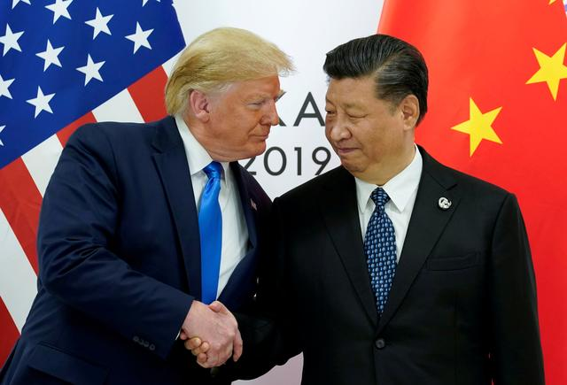 FILE PHOTO: U.S. President Donald Trump meets with China's President Xi Jinping at the start of their bilateral meeting at the G20 leaders summit in Osaka, Japan, June 29, 2019. REUTERS/Kevin Lamarque/File Photo