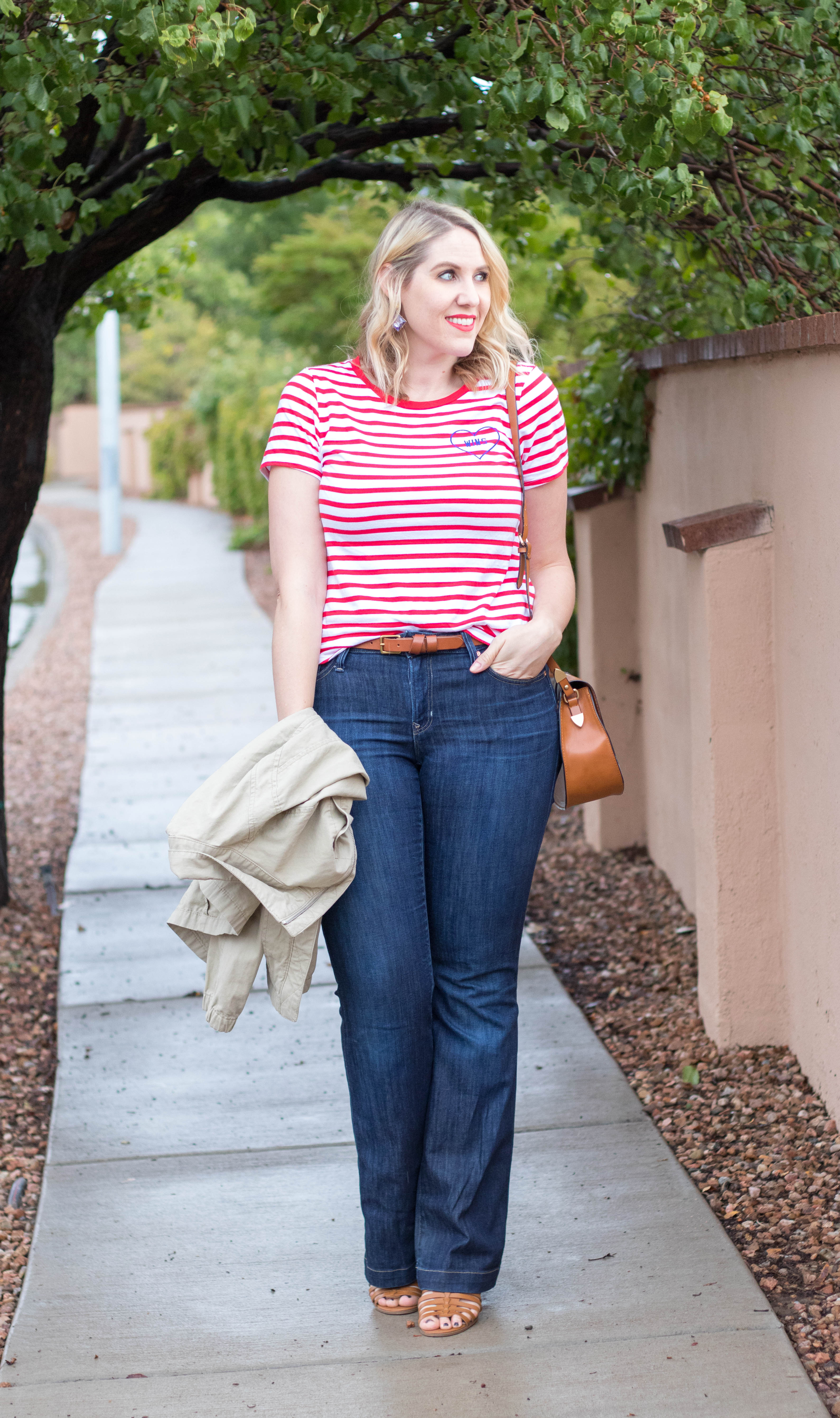 graphic tee for fall #theweeklystyleedit #fallstyle #graphictee #flarejeans