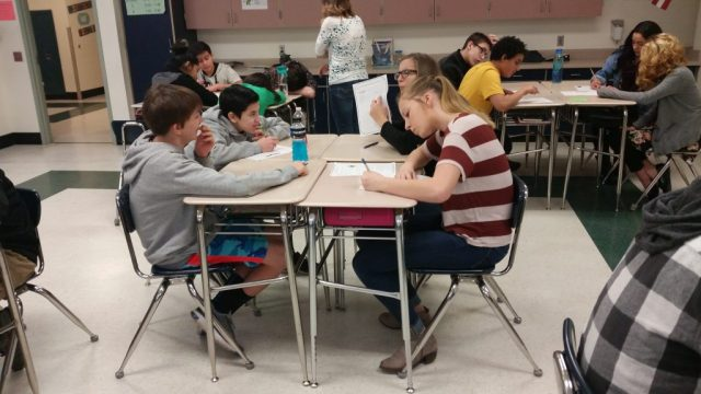 Students use nonverbal communication, plus writing to express their ideas.